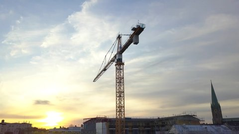 Linkoping, Sweden - May 12, 2019: Aerial view of construction site of new residential building wint tower crane.
