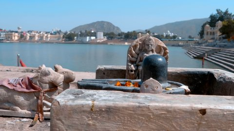 Shiva Lingam on the shores of the sacred Lake Pushkar in the town of Pushkar, India. Shot in motion
