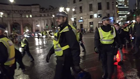 London, United Kingdom (UK) - 11 05 2015: A unit of riot police follow a night time protest