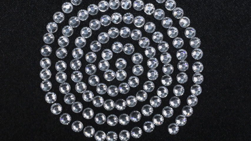 Rotation, close-up of a spiral of rhinestones. Trendy background. | Shutterstock HD Video #1030625903