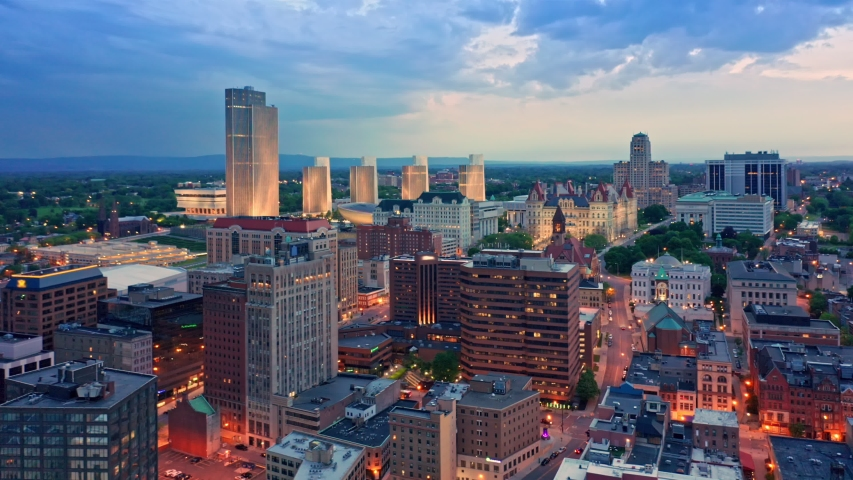 Drone footage of Albany, New York downtown at dusk, with uptilt camera motion. Albany is the capital city of the U. S. state of New York and the county seat of Albany County | Shutterstock HD Video #1030647743