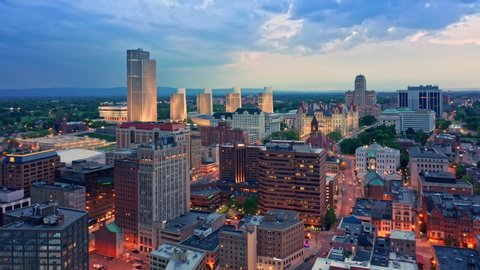 Drone footage of Albany, New York downtown at dusk, with uptilt camera motion. Albany is the capital city of the U. S. state of New York and the county seat of Albany County