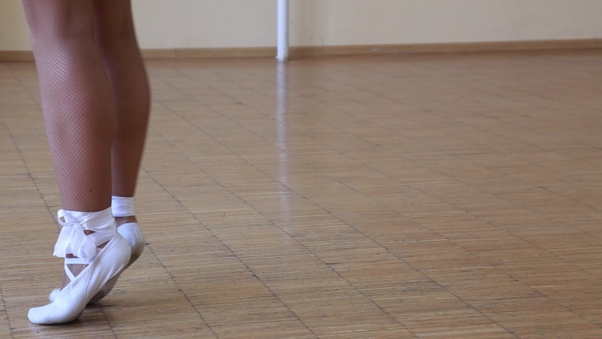 Ballerina in white pointe dancing on tiptoes . Feet close-up. | Shutterstock HD Video #1030694213