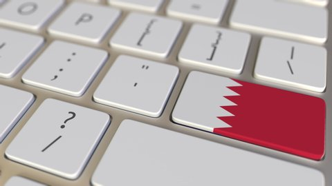 Key with flag of Bahrain on the computer keyboard switches to key with flag of the USA, translation or relocation related animation