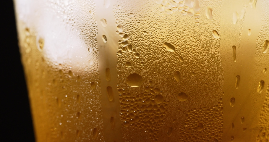 Beer Bubbles And Foam Close-up | Shutterstock HD Video #1030737173