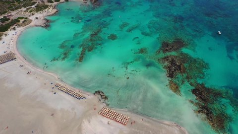 Aerial drone video of tropical caribbean bay with white sand beach and beautiful turquoise and sapphire clear sea