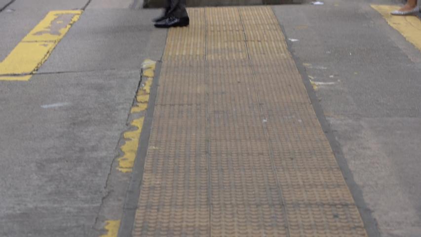 Slow motion of Pedestrians walking over the street in Hong Kong   Shutterstock HD Video #1030840103
