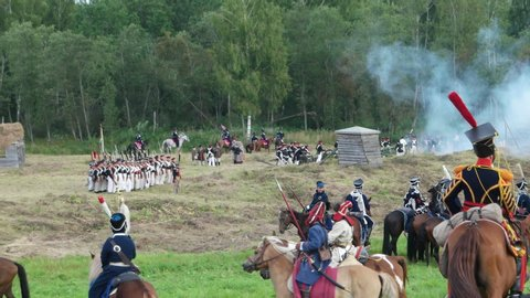 Borodino, russia - september 02, 2017 - reenactment of the battle of  borodino (the patriotic war of 1812 year)  tourists watch the performance  from from the fenced places