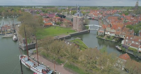 Aerial descending past sailing boats in in historic Dutch town Enkhuizen in North Holland the Netherlands