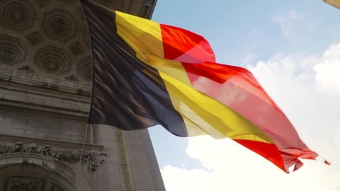 Belgium flag against tricolour stripes waving on wind from Arcade du Cinquantenaire 1920X1080 HD footage (1080p 50fps FullHD video)