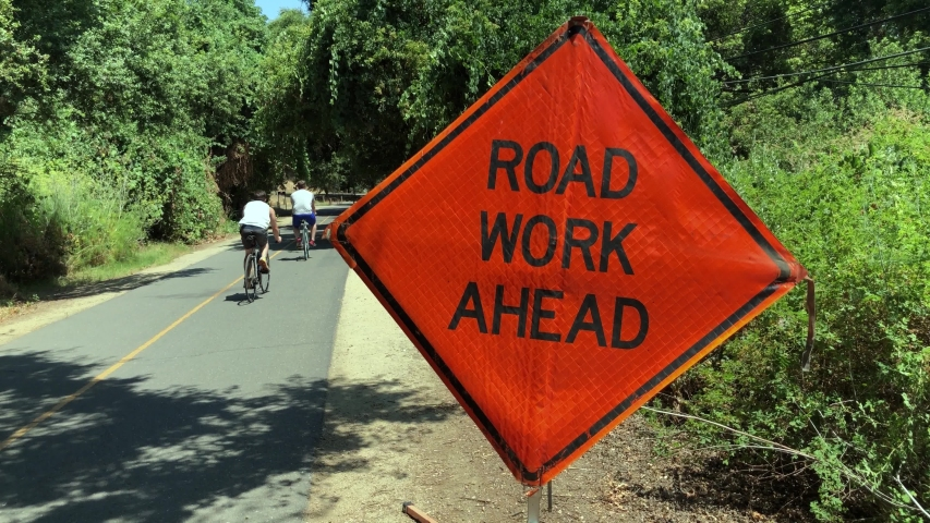 Road work ahead sign on a bicycle path | Shutterstock HD Video #1031078693
