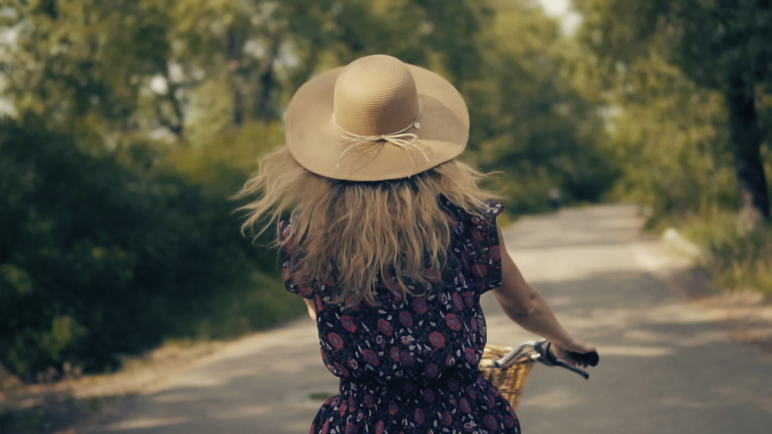 Cyclist Woman In Hat.Slow Motion Hair Flowing.Beautiful Girl Wearing Dress Rides Bicycle.Cycling Girl In Hat.Fluttering Locks.Hair Flying.Woman Hair Blowing Riding Bicycle.Cyclist Woman Bike Riding. | Shutterstock HD Video #1031089133