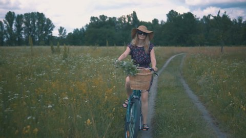 Woman On Bicycle.Girl Cycling.Girl Riding On Bicycle.Woman Cyclist.Girl Bicycle.Beautiful Girl Wearing Dress Rides On Bicycle.Woman Bike Riding.Cycling Female.Bicyclist Woman Retro Bike.Basket On Bike