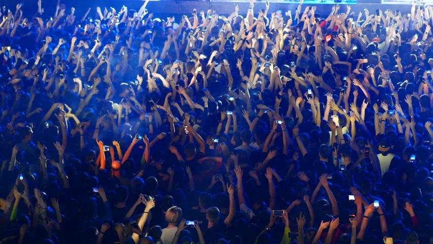 Joyful crowd enjoys listening famous group rock concert | Shutterstock HD Video #1031102393