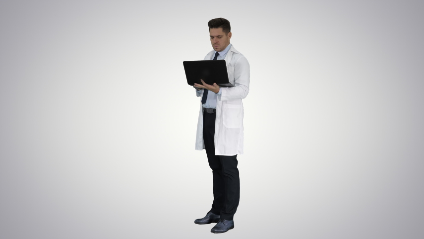 Doctor showing results in laptop on gradient background. | Shutterstock HD Video #1031214203