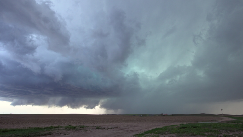 Clouds spinning in the sky during severe storm in Nebraska as lightning flashes over the plains. | Shutterstock HD Video #1031220083