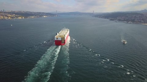 Istanbul Bosphorus Aerial Ro-Ro ship sails out. A PCTC Pure car and truck carrier underway in Turkish Straits. She is heading towards the suspended bridge