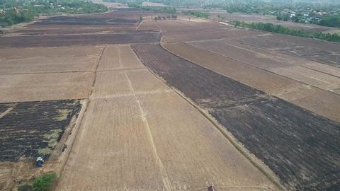 Burning rice field after harvesting burning rice straw for farming new rice northeast Thailand