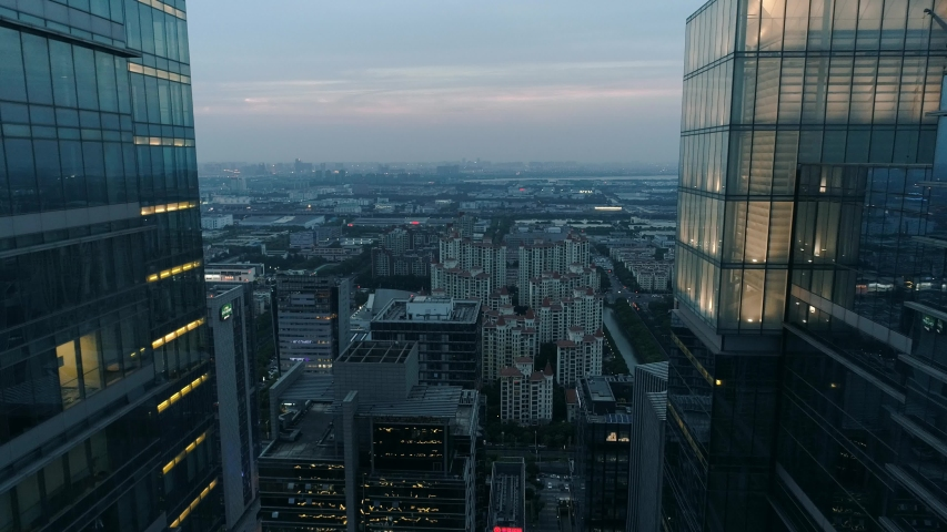 Suzhou, China - June 12, 2019: Aerial over modern business office buildings, skyscrapers, financial district, cityscape with downtown buildings at sunset. | Shutterstock HD Video #1031295713