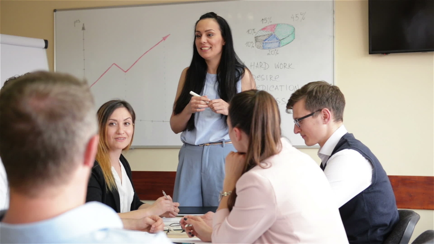 Female Teacher Coach Mentor Leader Speaking Teaching Diverse Staff Students Interns At Group Office Meeting. Executive Manager Speaker Training Employees Consulting Clients At Team Corporate Workshop. | Shutterstock HD Video #1031326043