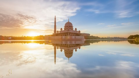 Beautiful Cloudy sunset Time Lapse at Putra mosque by a lake in Putrajaya, Malaysia at dusk.