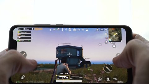 SOCHI, RUSSIA-JUNE 12, 2019: Man is playing in PUBG FPS game on smartphone