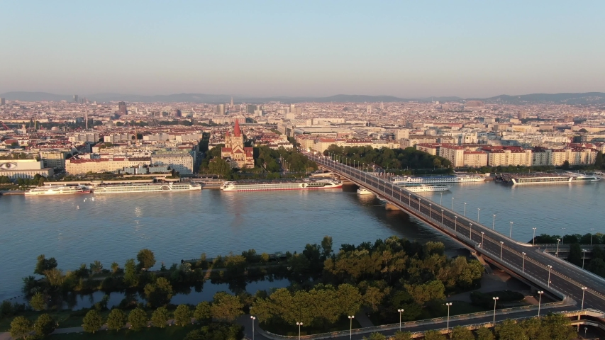 VIENNA, AUSTRIA – JUNE, 2019: Early morning panoramic view of the city and bridge over the Donau river. | Shutterstock HD Video #1031542283