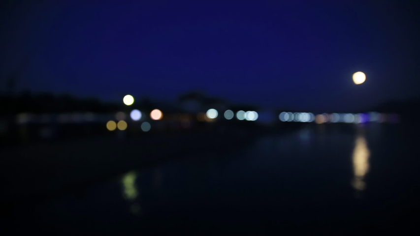Night view on coast of Sudak town. from the Black sea. Crimea. Defocused background. | Shutterstock HD Video #1031548853