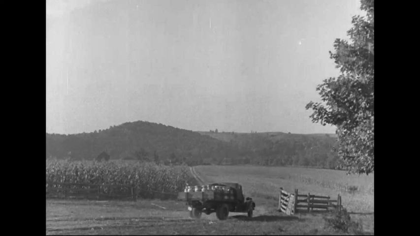 CIRCA 1940s - A farmer and his farmhand son saw, chop wood, harness horses and plow alfalfa in farmlands in Warnock, Ohio, in 1940. | Shutterstock HD Video #1031627033