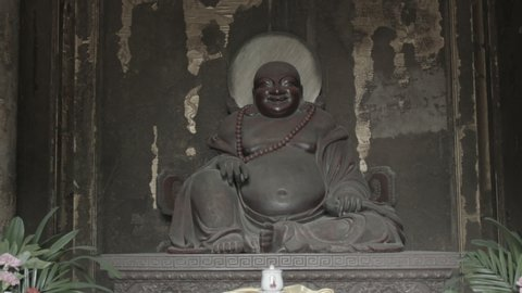 Statue of Biddist deitiy in the chinese temple.