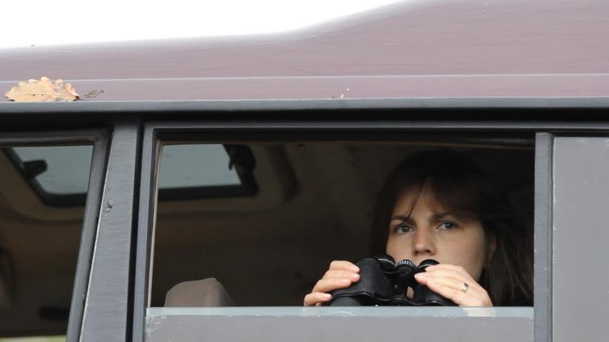 Biologist researcher woman birdwatching with binocular in nature | Shutterstock HD Video #1031677583