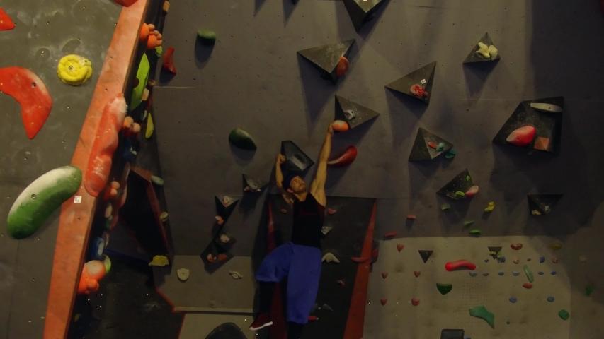 Cluj, Romania - 11 03 2018: People practicing climbing on a wall | Shutterstock HD Video #1031741783