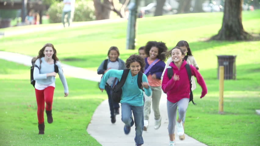 Slow motion sequence as group of children run along path towards camera.Shot on Sony FS700 at frame rate of 100fps