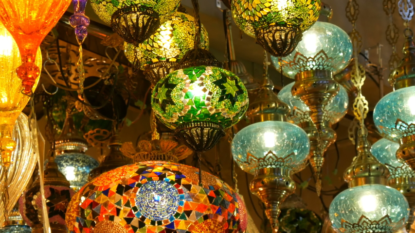 Multi-colored Turkish mosaic lamps on the ceiling market in the famous Grand Bazaar in Istanbul, Turkey   Shutterstock HD Video #1031802833