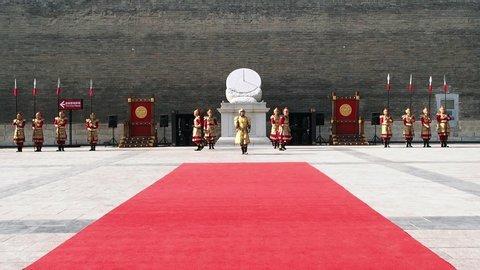 Xian city, Shaanxi province, China - May 25, 2018: Change of the guard at Xian city wall entrance hall