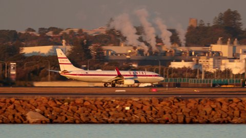 """Sydney, Australia - May 31, 2019:  Qantas Boeing 737-838 VH-VXQ """"Retro Roo II"""" in the historic qantas colours celebrating the 95th anniversary of Qantas takes off from Sydney airport."""