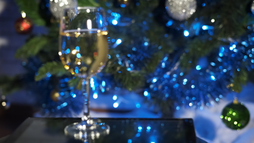 Christmas tree focusing. Glass in the foreground. Holiday. Merry Christmas.   Shutterstock HD Video #1032010943