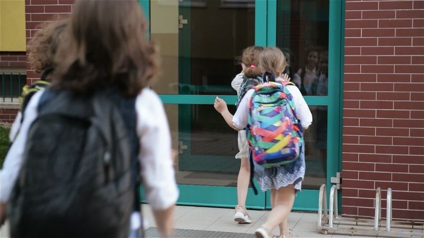 Children With Backpacks Running To School. Two Boys And Two Girls Are Returning On Lessons Near The School. Back To School. Late Pupils Concept. | Shutterstock HD Video #1032395123