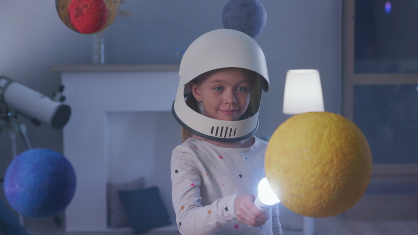 Interstellar Inspiration of Epic Nasa Mission out Earth Globe. Night Dreamy Spaceman Walking Indoors. Baby Lifestyle of Small Playful Person. Cheerful Light of Beautiful Fly to Modern Global World   Shutterstock HD Video #1032439403