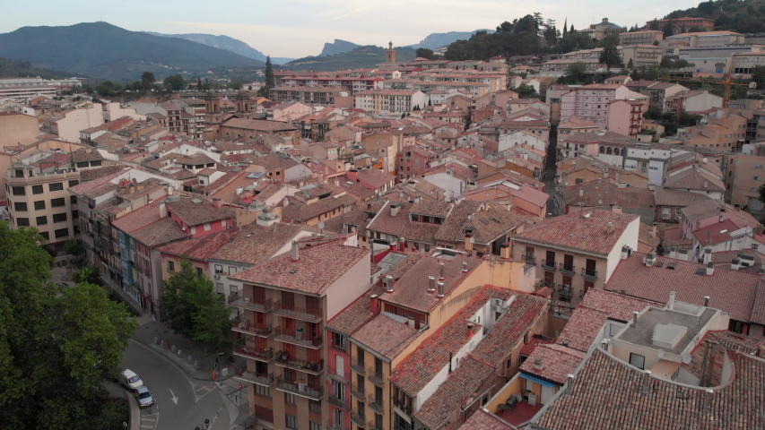 Aerial view of Estella, Spanish village along Camino de Santiago or Way of Saint James. Urban landscape with bridge and river in Navarra region, Spain seen from drone flying in sky | Shutterstock HD Video #1032445523