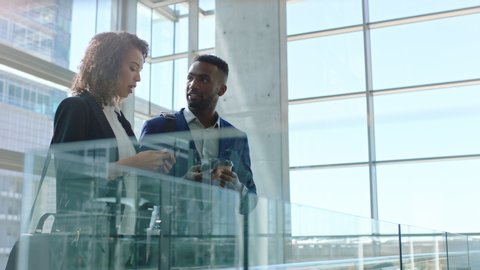 business people shaking hands african american businessman meeting female colleague in corporate office greeting with handshake welcoming client 4k
