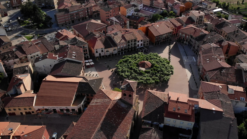 Aerial view of Belorado, Spanish village in the province of Burgos, Castile-Leon, Spain along Camino de Santiago or Way of Saint James. Old church and square seen from drone flying in sky | Shutterstock HD Video #1032518363