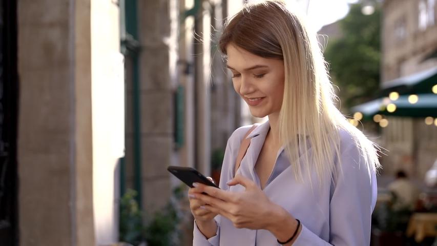 Beautiful young woman wearing blue shirt | Shutterstock HD Video #1032611873