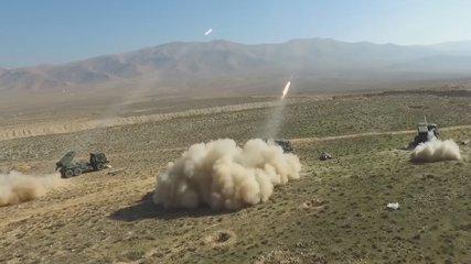 Syria outskirts of Deir ez-Zor. hail rocket launchers fire