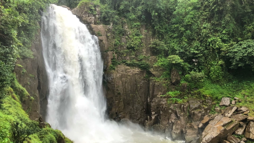 Haew Narok Waterfall in large deep forests is With a floating water spray at Khao Yai National Park, Nakhon Nayok, Thailand. #1032940433