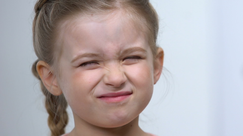 Female child squinting eyes wearing optical trial frame, eye examination, myopia | Shutterstock HD Video #1032949883