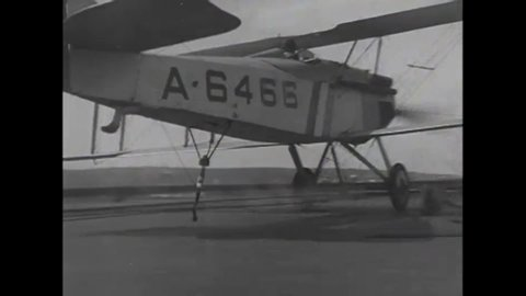 Circa 1923 - slow motion is used to show biplanes landing on the uss  langley with varying degrees of success
