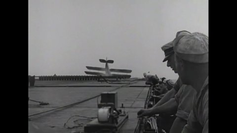 Circa 1924 - slow motion is used to show a biplane crash landing on the uss  langley