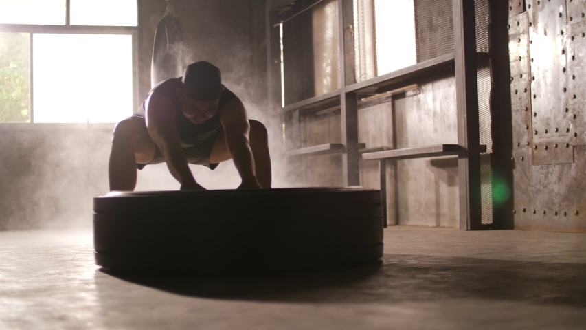Sporty man exercising building muscles at the gym | Shutterstock HD Video #1033019903