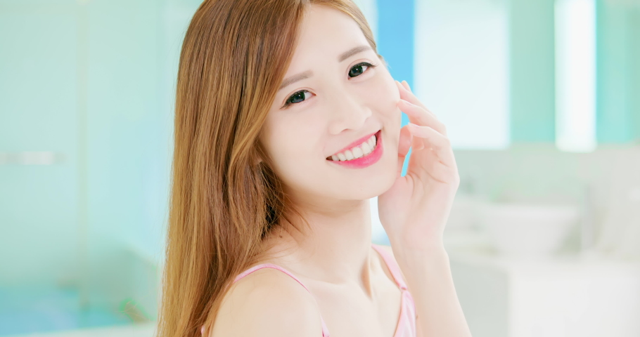 Skin care concept - slow motion of asian girl smile to you